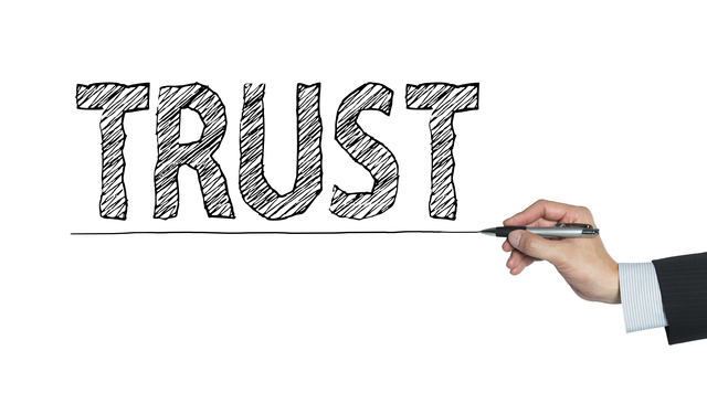 trust written by hand, hand writing on transparent board, photo